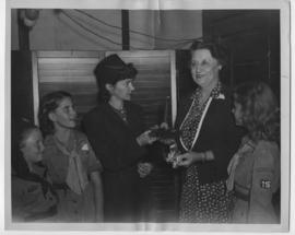 Henriette de Beaulieu being presented a corsage by the Brownies