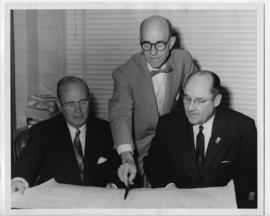 Robert V. Moise Aubrey Calvin and Henry A. Stubee studying building plans